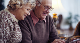 older couple looking at their smartphone
