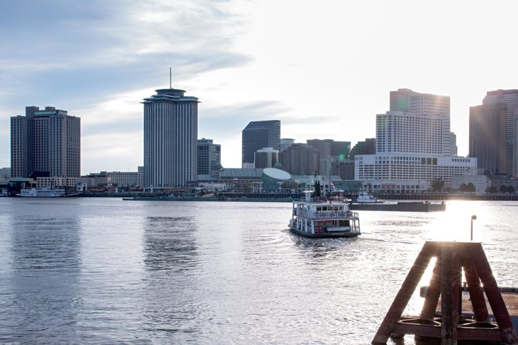 riverboat overlooking downtown new orelans with the sun shining