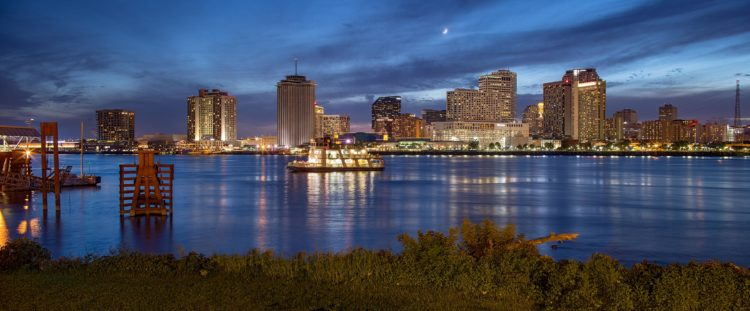 riverboat at night overlooking downtown new orleans